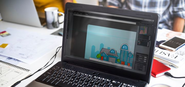 laptop screen showing graphic house exterior desig